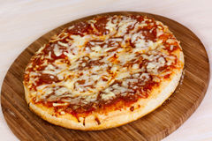 Close up of pizza with tomatoes, cheese, black oli Stock Photo