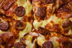 Close up of Pizza top view / delicious tasty fast food italian traditional pizza cheese. With Mozzarella , Smoked pork sausage , Pineapple ham on topping sauce stock photos