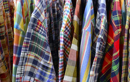 Close up of plaid clothes. A close up of plaid clothes hanging on a rack royalty free stock photo