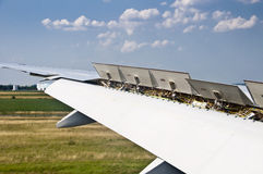 Close up on plane wing spoiler Stock Images