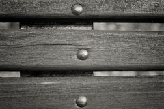 Close up planks from an old wooden bench. Black and white toning Royalty Free Stock Photo