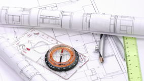 Close up of plans and design tools turning Royalty Free Stock Photography