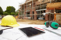 Close Up Of Plans And Digital Tablet On Building Site Royalty Free Stock Image