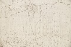 Close-up on a plastered painted wall. Light gray, old, cracked wall surface stock photos