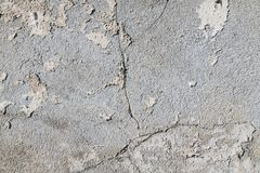 Close-up on a plastered wall. Old, cracked wall surface royalty free stock images