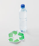 Close up of plastic bottle and recycling symbol Stock Image