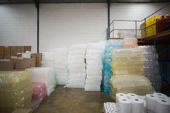 Close up of plastic packaging and paper roll. In a large warehouse stock images