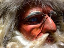 Santa stare. Close up of plastic santa`s face royalty free stock images