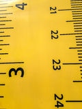 Close up of Plastic Yellow Ruler for Kids Background Texture Stock Photography