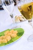 Close up on a plate of cheese with Wine Glasses Royalty Free Stock Photo