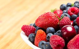 Close up of plate full of berries on table Stock Images