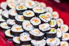 Close up of a plate full with sushi rolls. Stock Photos