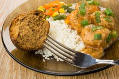 Close up of plate with meatballs, rice, vegetable mix, bun Stock Image
