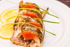 Roasted zander fillet with asparagus and lemon. Close up plate with pike perch fillet, lemon, tomato and asparagus. Healthy diet concept Royalty Free Stock Images