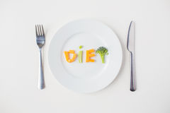 Close up of plate with vegetable diet letters Stock Photos