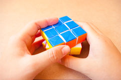 Close up play puzzle rubik cube Stock Photos