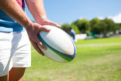 Close up of player holding rugby ball Stock Photography