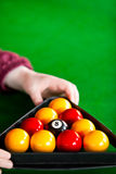 Close-up of a player placing billiard balls Stock Photography