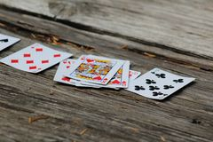 Close-Up of Playing Cards on Old Outdoor Wooden Table royalty free stock photo