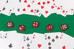 Close up of playing cards and red dices on the green table Stock Photo