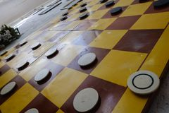 Close up of playing draughts or checkers board game. Intellectual hobby royalty free stock photography