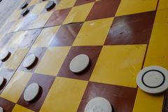 Close up of playing draughts or checkers board game. Intellectual hobby royalty free stock photos