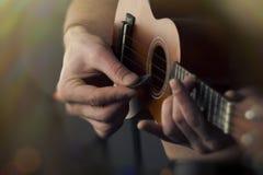 Close Up Playing Ukulele. Closeup shirtless male musician playing soprano ukulele Stock Photos