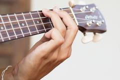 Close up playing ukulele , touch chord ,string instrument  , bod Royalty Free Stock Photos