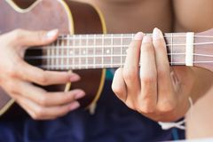 Close up playing ukulele , touch chord ,string instrument  , bod Stock Images