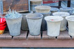 Close up of plenty empty clay flower pots for sale. Garden and interior decoration stock image
