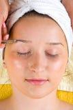Close up of plucking eyebrow Stock Image