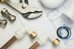 Close up of plumbing paraphernalia on house blueprint Royalty Free Stock Photo