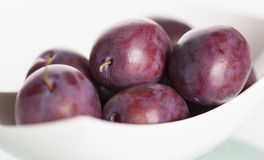 Close up of plums on plate. Stock Photos