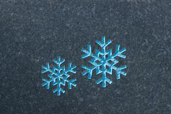 Snowflakes ingraved on  stone surface. Close up pn two snowflakes on stone surface. Memorial Stone, Johannisfriedhof, Dresden, Germany Royalty Free Stock Photography