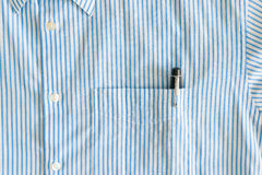 Close Up of the Pocket with Black Pen and Buttons Royalty Free Stock Photos