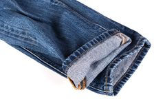 Jeans on isolated background. Close up the pocket and seam, sewing of denim blue jeans texture stock photography