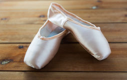 Close up of pointe shoes on wooden floor Stock Image