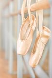 Close up of pointes for ballet hanging on barre Royalty Free Stock Image