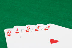 Close up of poker cards with royal flush combination on green ta Stock Photography