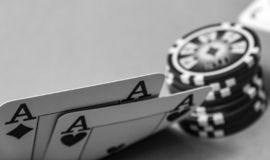 Close up poker cards two aces lifting corner royalty free stock photo