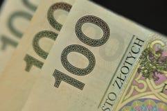 Close up of Polish 100 zloty notes. Close up of Polish 100 zloty (PLN) banknotes on a black background stock photos