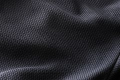 Close-up polyester fabric texture of black athletic shirt Stock Photos
