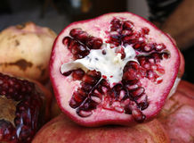 Close up of pomegranate. Half open pomegranate in close up Stock Photography