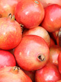 Close up of pomegranate on market  at a fruit and vegetable market. Royalty Free Stock Images