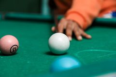 Close-up of pool shot on rustic table Royalty Free Stock Photos