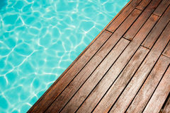 Close up of Pool and wooden floor Royalty Free Stock Photos