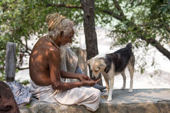 Close up poor man and dog. India Stock Photography