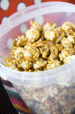 Close up popcorn in bucket. Close up caramel popcorn in plastic bucket Stock Photography