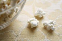 Close-up of popcorn near bowl Royalty Free Stock Image