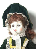 Close up of porcelain doll. Close up of ginger hair porcelain baby doll wearing green velvet dress and hat Stock Images